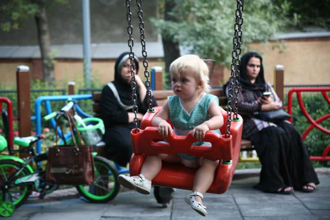 a child is playing in the park in Iran